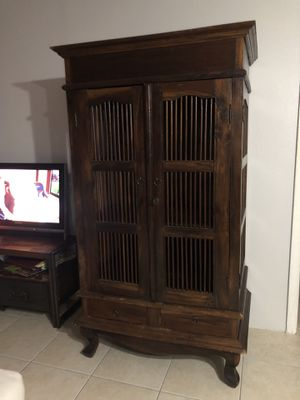 Armoire in wood/Length 39in width 27in height 67.75 inches for Sale in Miami, FL