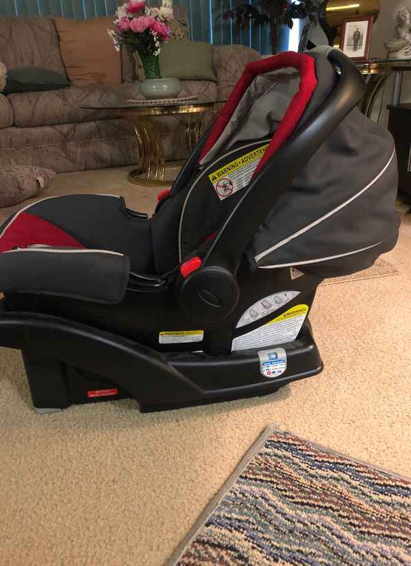 Graco Red and Black car seat