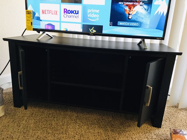 TV Stand / Entertainment center - Blackwood ( Excellent condition - Firm)