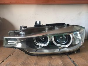 BMW 328i FRONT LEFT DRIVER SIDE XENON HEADLIGHT ASSEMBLY for Sale in Oakland Park, FL