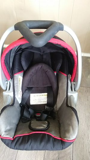 Black and red infant car seat with neck roll. for Sale in Philadelphia, PA