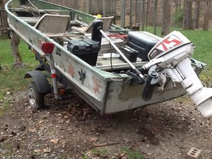 14 foot bass boat 5 hp gas runs great 35 of troll motor lots of gear nets for crabs fish etc to much other stuff to mention for Sale in Owings, MD