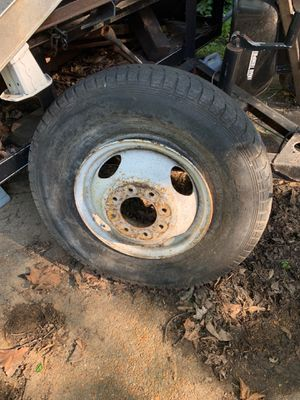Older Chevy dually wheel and 234/85/16 old tire for Sale in Overland, MO