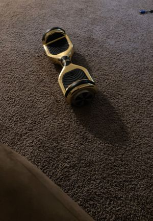 Gold hoverboard (needs new battery dies fast) for Sale in Raleigh, NC