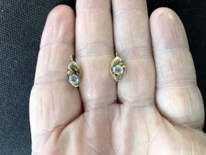 New. 14k yellow and moissanite earrings. Solid gold. Moissanite is a natural birthstone that looks similar to a diamond. Great gift for the woma for Sale in Fullerton, CA