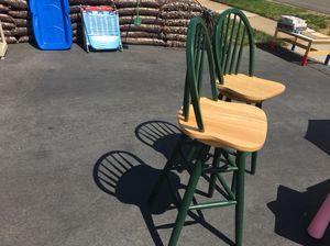Price for sale: Two real wood swiveling bar stools $25 for Sale in Fairfax, VA