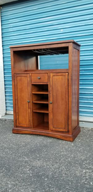 Bar cabinet with tile inserts. Has a small stemware rack and a mirrored back. for Sale in Phoenix, AZ