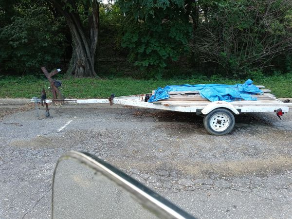 17' boat trailer w/ 2 4'×8' plywood sheets bolted down for option of flat bed cargo trailer. New wheels and barings, lighting and hitch.
