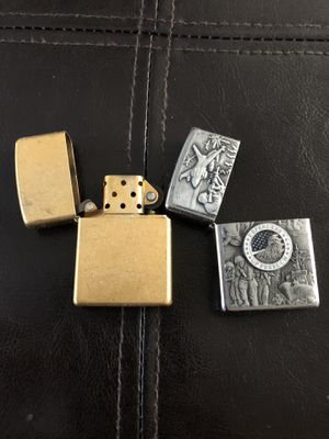 Gold/brass full complete Zippo Lighter. Come with silver color Defenders of Freedom Zippo case. $30 for Sale in San Diego, CA