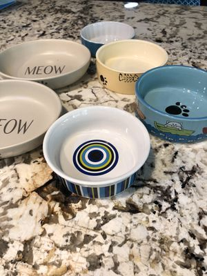 7 Ceramic Cat Dishes and 1 Mat for Sale in Glendale, AZ