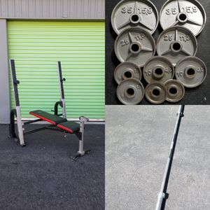 Weight bench adjustable with Olympic weights and barbell 35x25x10x5x2.5 for Sale in North Las Vegas, NV