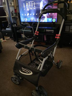 Snap-N-Go Universal Car Seat Carrier for Sale in Elyria, OH