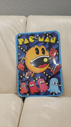 "Pacman video game metal door wall sign measures 9x13"" embossed metal brand new with hole at the top for easy hanging for Sale in Ontario, CA"