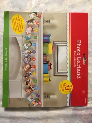 Baby Photo garland holds 13 pictures multi color baby's 1st year new for Sale in Tamarac, FL