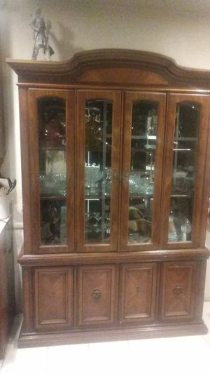 It's an antique china cabinet with a 12 peace setting of China the maker is m i k a b a yea it's really expensive for Sale in Cerritos, CA