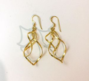 Sterling silver earrings plated with 24k gold for Sale in West Covina, CA