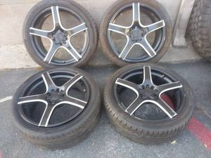 20 inch 5 lug multipattern black rims with caps and tires. for Sale in Montebello, CA