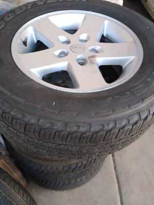 245 65 17 Jeep wheels and tires for a Cherokee for Sale in Phoenix, AZ
