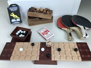 Wooden puzzles, playing cards, pin pong balls and paddles, marble game for Sale in Miami, FL