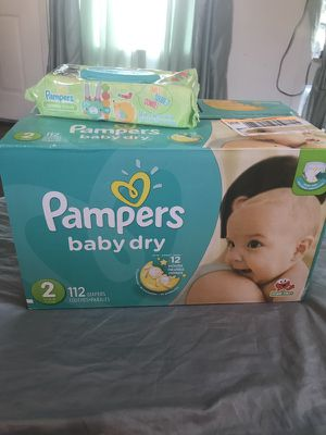 Pampers size 2 diapers and a pack of wipes for Sale in Spokane, WA