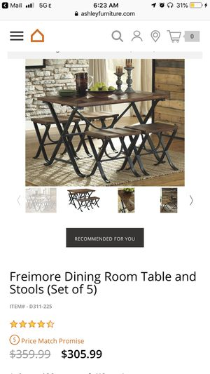 Freimore dining room table & stools for Sale in Maryland City, MD