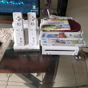 Wii Game System With Two Controllers And 5 Games for Sale in Miami, FL