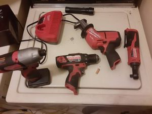 Milwaukee m12 tools 1 2.0ah battery 1 4.0ah battery and charger for Sale in Mesa, AZ
