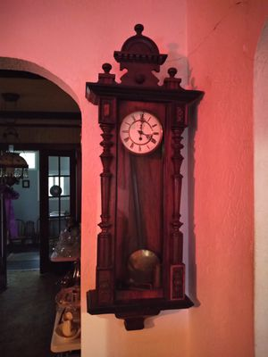 Antique clock. German. Needs some repair but not sure of extent. The pendelium is not attached but can be put back on. Length 4 feet. for Sale in Portsmouth, VA
