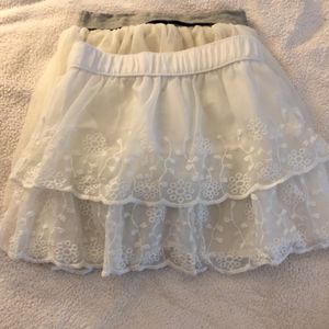 Children's Clothing Brand New> Girls size m> 2 skirts> 1 Gap Tulle skirt MSRP $26.95 • Carter's White lace layers skirt $19.99 for Sale in Houston, TX
