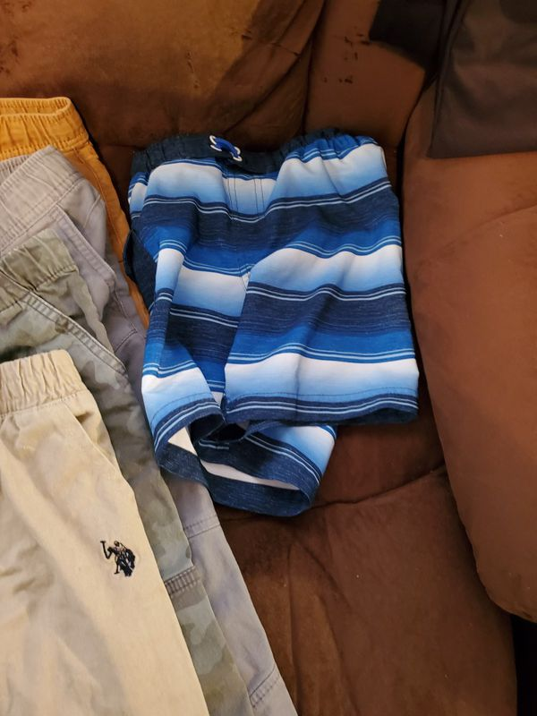12 piece lot of jeans,pants, and shorts/ swimming trunks