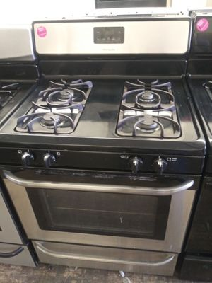 Frigidaire black and stainless steel 4-burner gas for Sale in Cleveland, OH