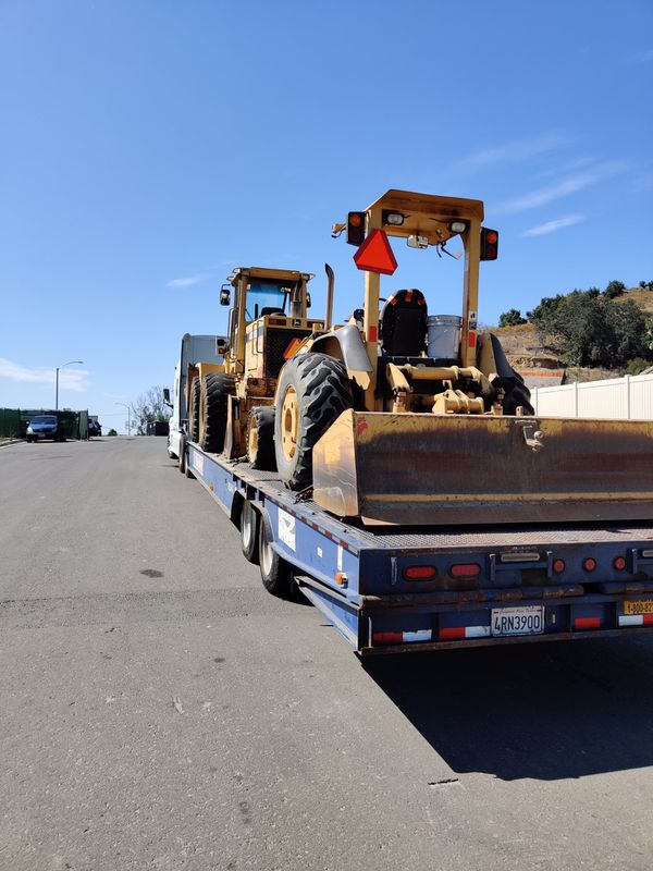 Equipment transportation, backhoe , John Deere