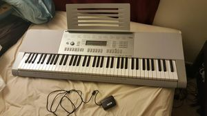 Casio electronic keyboard WK-225 with stand and sheet music for Sale in Lynnwood, WA