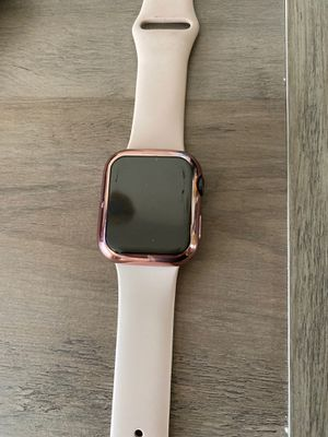 Apple Watch series 5 44 mml aluminum case with pink band and rose gold case for Sale in Turlock, CA