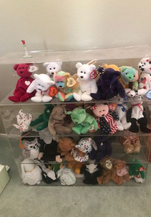 Collection of Beanie Babies in glass shelf for Sale in Rowland Heights, CA