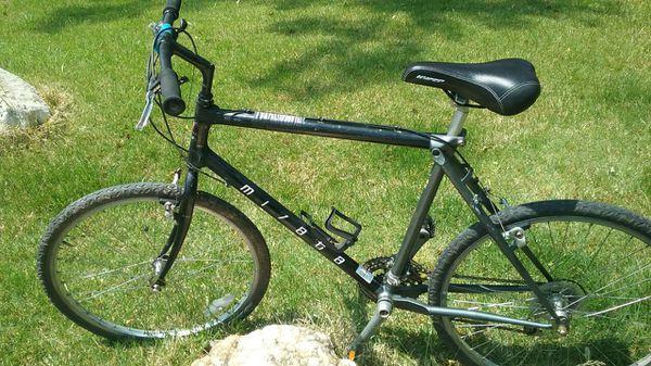 black and gray hard tail mountain bike Road bike cruiser.