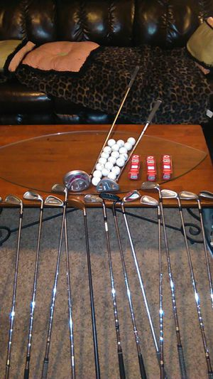 Set of ladies golf clubs 17 golf clubs over two dozen balls and golf bag lady Edge Titleist golf clubs among a few other brands for Sale in St. Louis, MO