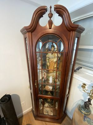 Corner cabinet with light and glass shelves good condition for Sale in Silver Spring, MD