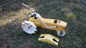"""NELSON"" Cast iron large traveling Lawn Sprinkler tractor in a yellow color with white wheels for Sale in Johns Creek, GA"