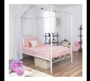 Twin size heart detail white metal canopy bed. Mattress not included. for Sale in Mundelein, IL