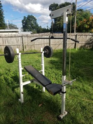 Bench with bars and weight for Sale in Largo, FL