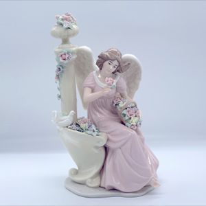 PORCELAIN ANGEL WITH FLOWERS BY COLUMN FIGURINE. for Sale in Las Vegas, NV