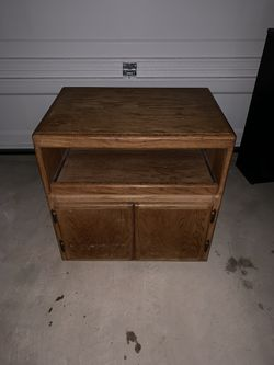 Small cabinet with slide out shelf and bottom storage for Sale in Austin,  TX