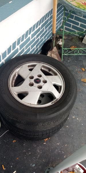 Pontiac aztek rims and tires set of 4 with spare for Sale in Tarpon Springs, FL