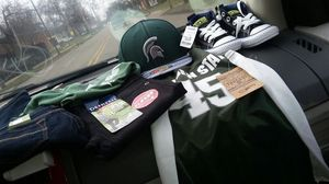 Spartans hat jersey shirt and levi pants 5 and 6 for Sale in Detroit, MI