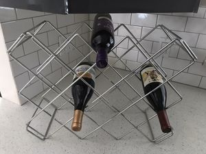21 bottle metal wine rack top shelve holds large bottles for Sale in Oakland Park, FL