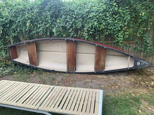 Fiberglass canoe with electric motor. 5 speed for Sale in Ocean Township, NJ