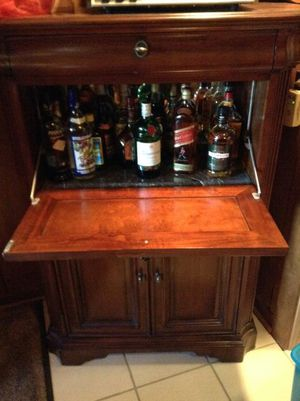 Nice bar and wine cabinet with granite shelve for Sale in Cleveland, OH