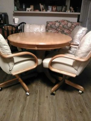 Oak table and 4 Captain chairs, butter leather, cream, from undecided estate sale, must go, this peice has been lowered to 225.00 )as of Sept. 3 , for Sale in Philippi, WV