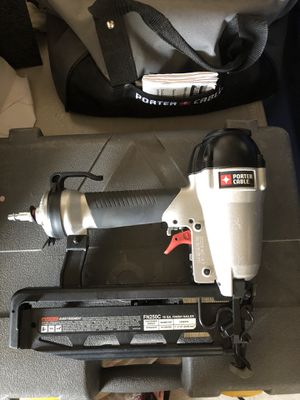 Nail gun ,air hose and bag with nails for Sale in Las Vegas, NV